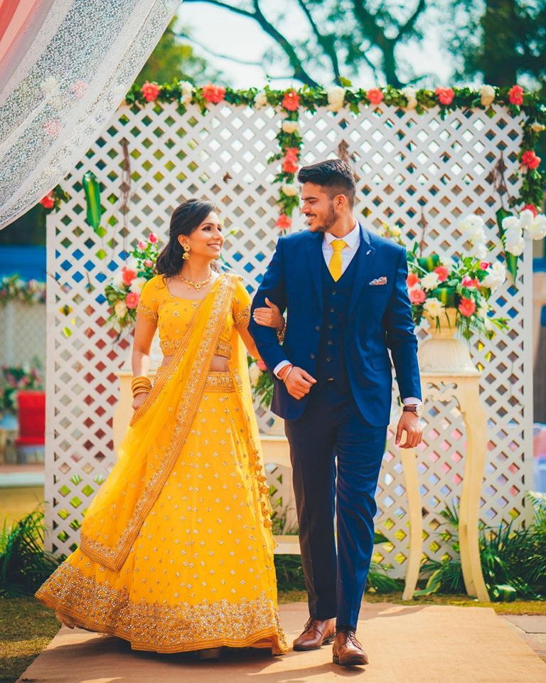Bride and Groom Hand in Hand Entering for Their Haldi Ceremony