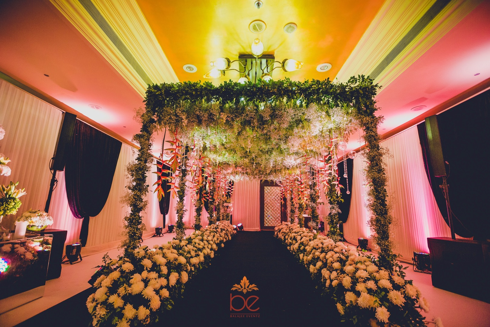 Beautiful White Floral and Green Tropical Arch Entrance Decor with Crystals