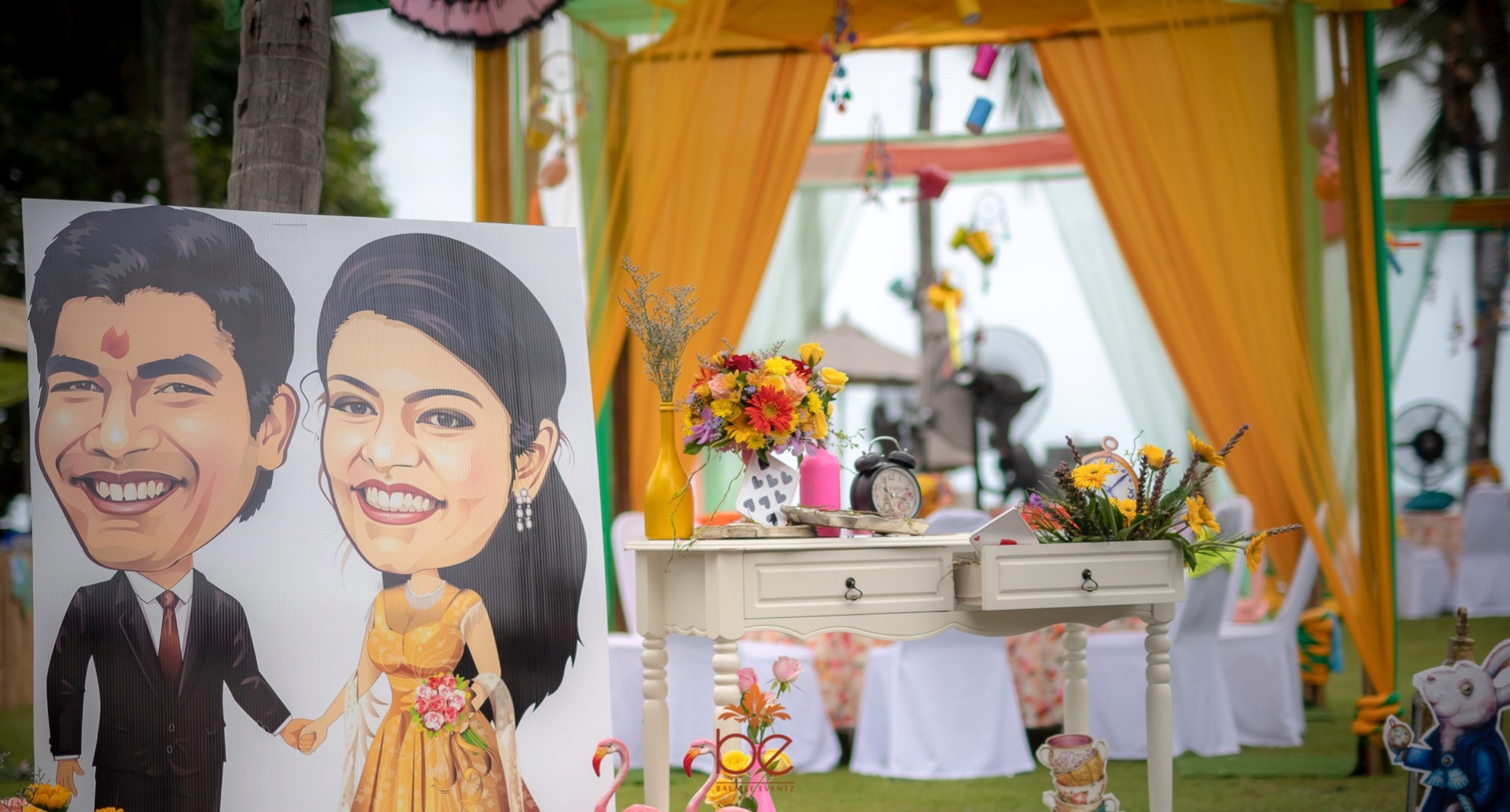 Couple Caricature Board and Colorful Floral Outdoor Decor