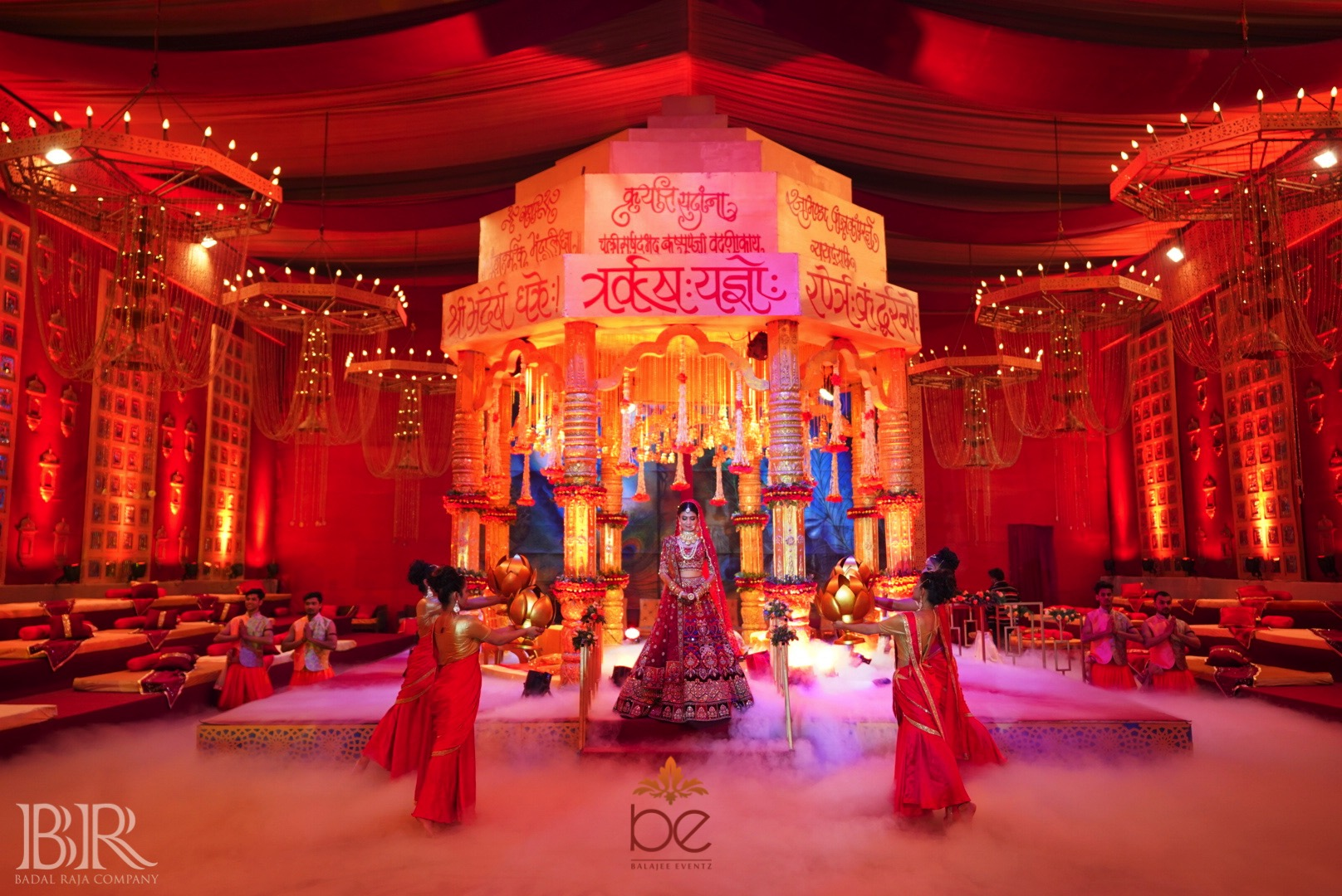 Bride in a Grand Traditional Indoor Mandap and Wedding Setup