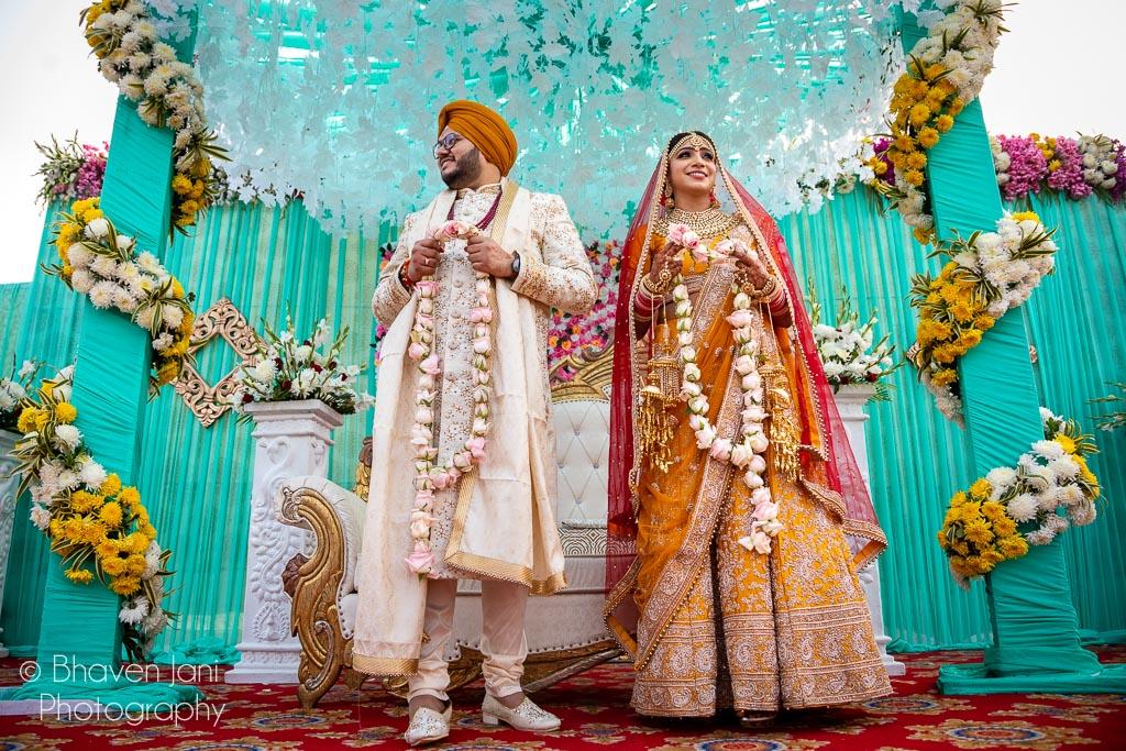 Bride & Groom During Jaimala Ritual in Sikh Wedding Picture