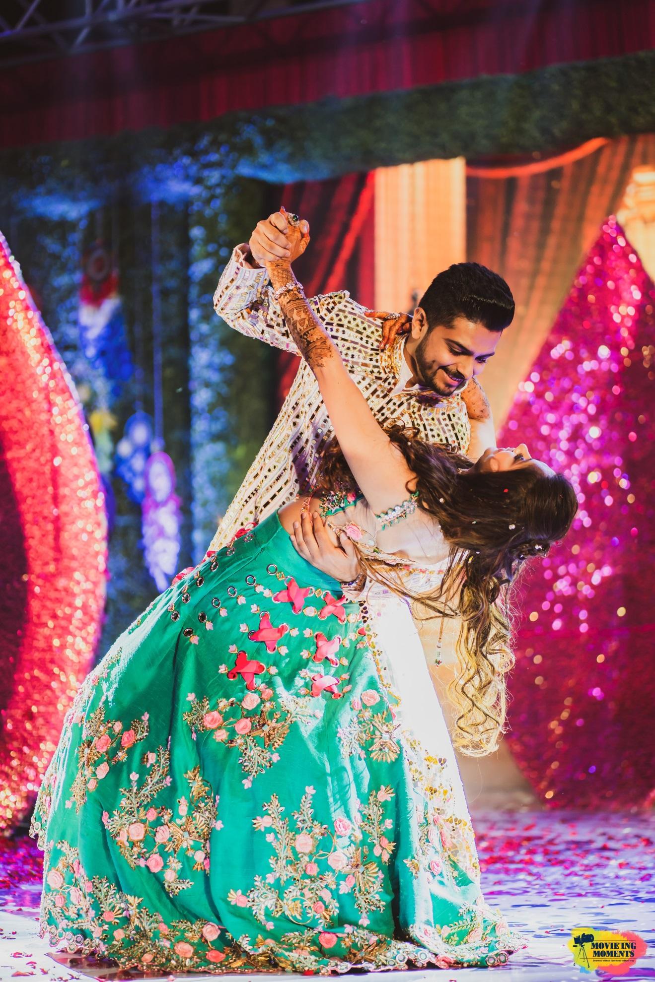 Bride and groom sangeet dance