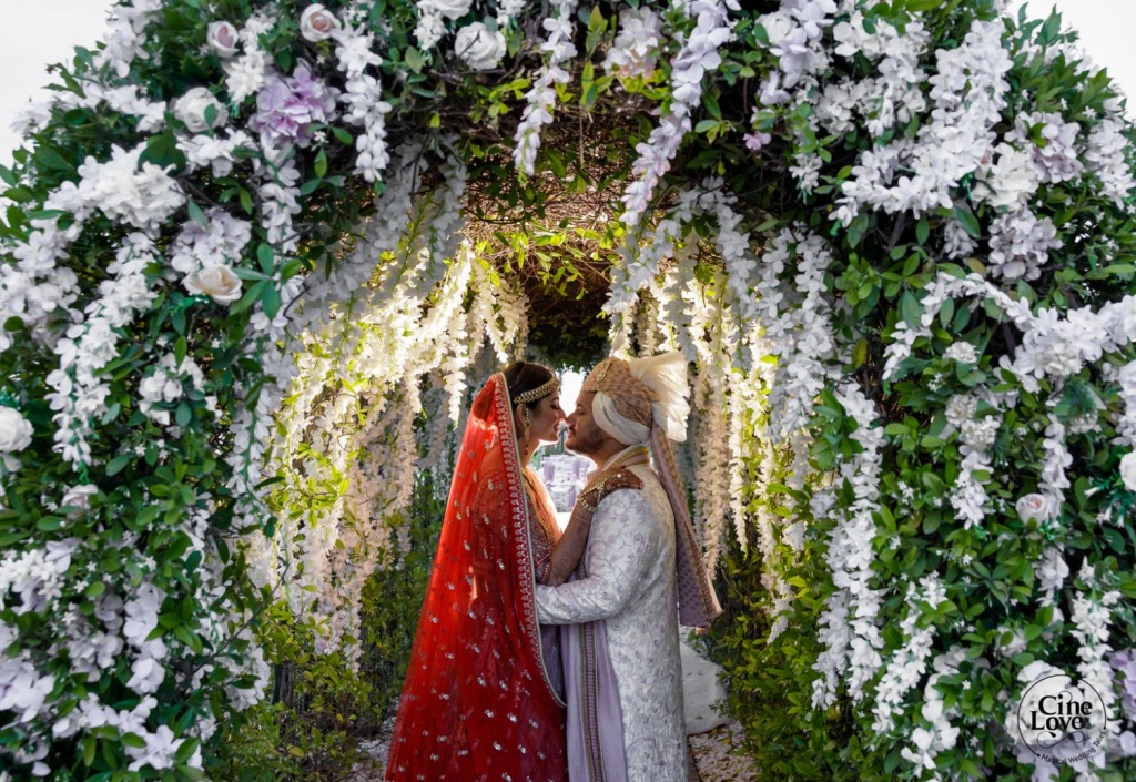 Bride & Groom Romantic Picture in White & Green Floral Arch