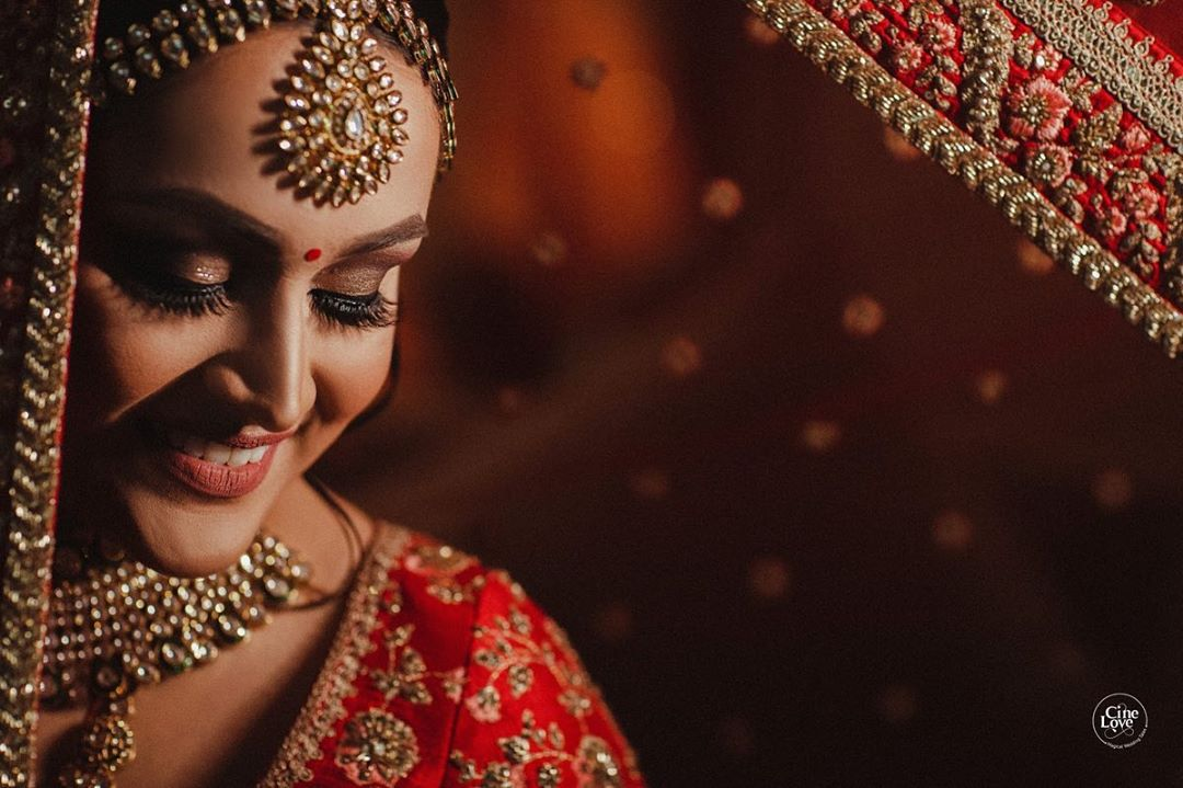 Happy Bridal Portrait Solo in an embellished Red Lehenga