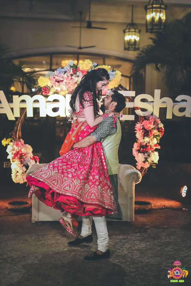 Groom Carrying the Bride in Arms in Mehendi Ceremony