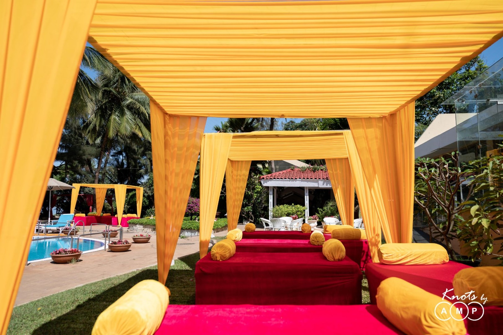 Mehendi Ceremony Seating Setup with Yellow Drapes and Cushions