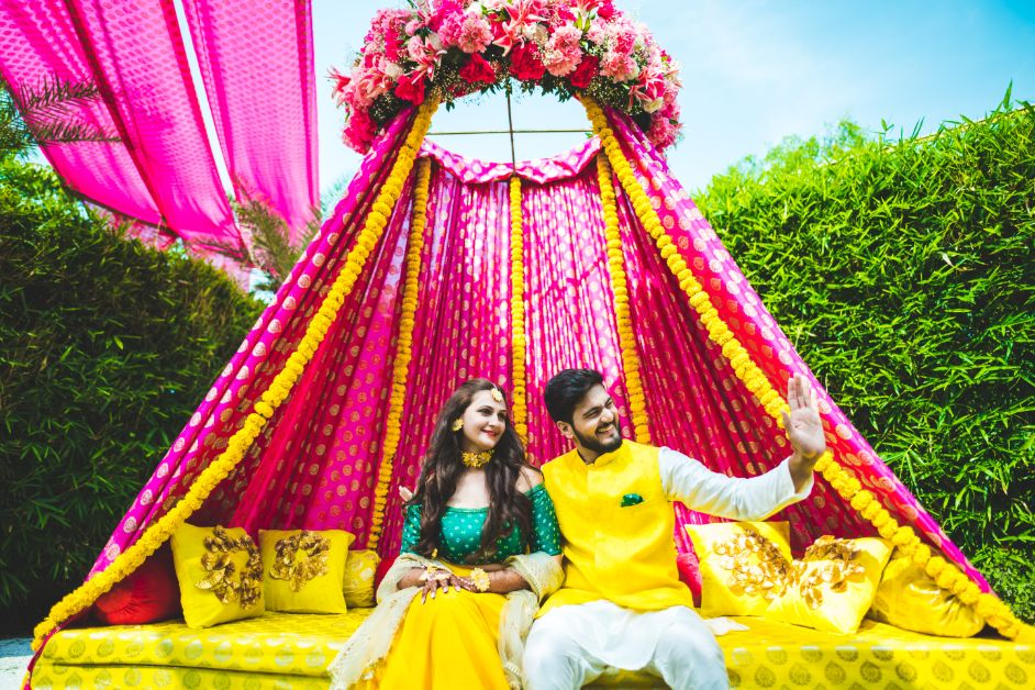 Pink & Yellow Floral Mehendi Ceremony Couple Seating Setup