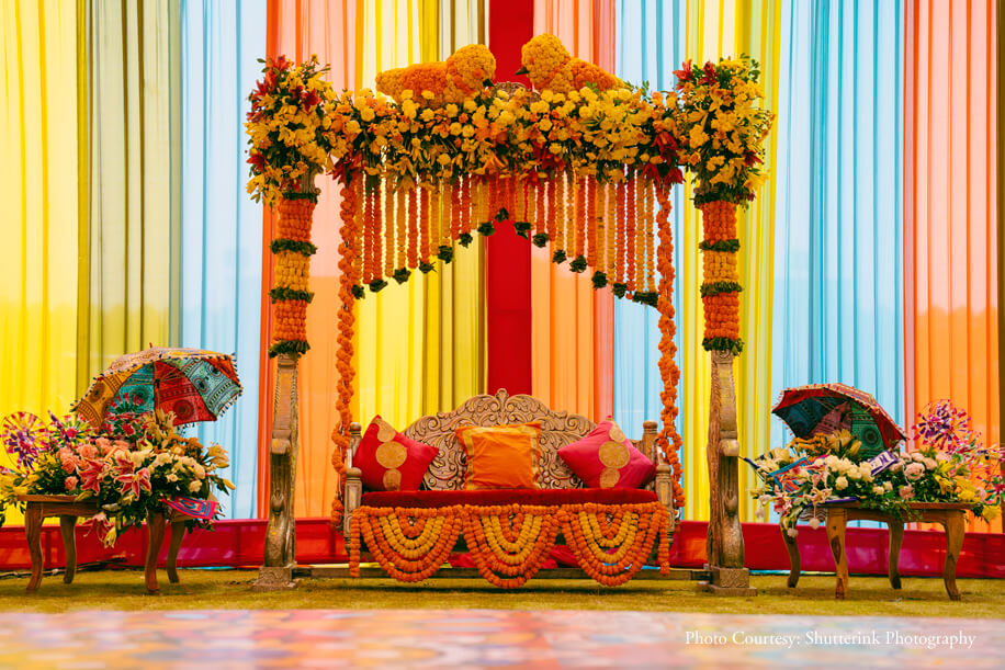 Beautiful Marigold and Floral Mehendi Ceremony Swing Seating Decor