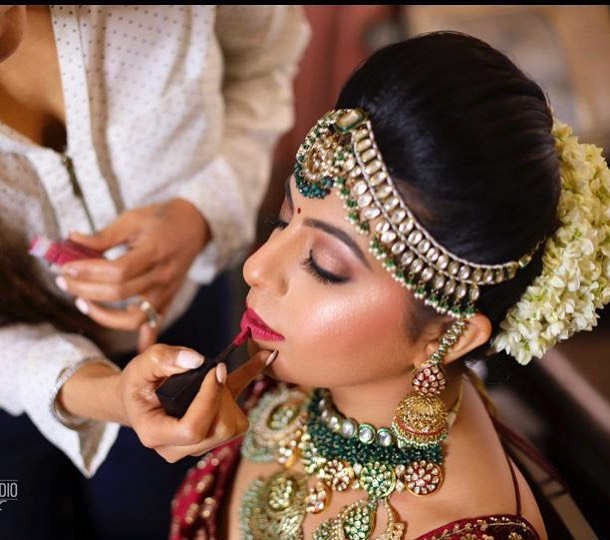 Beautiful bridal red lehenga hair and makeup