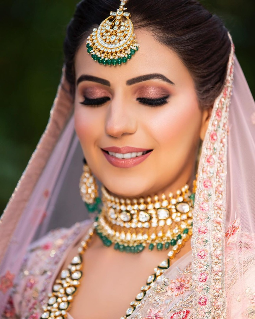 Beautiful Indian Bride with Natural Makeup in Pink Lehenga