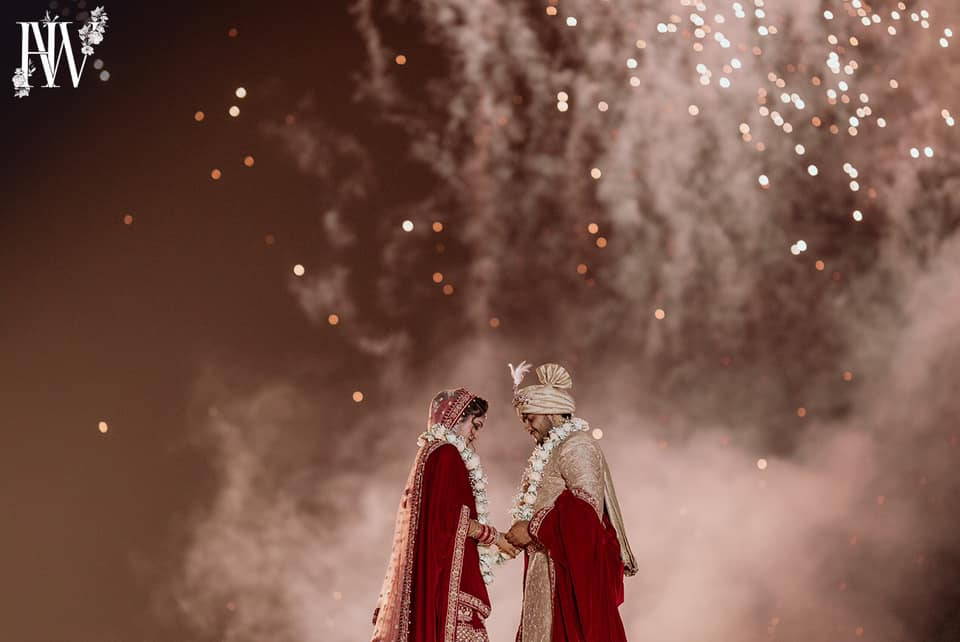 Bride and Groom Jaimala Moment with Fireworks Around