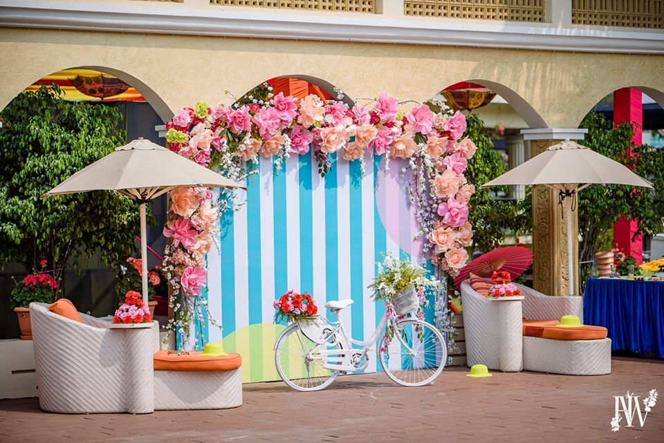 Colorful Paper Flower Photobooth Backdrop with White Flower Decorated Cycle Prop
