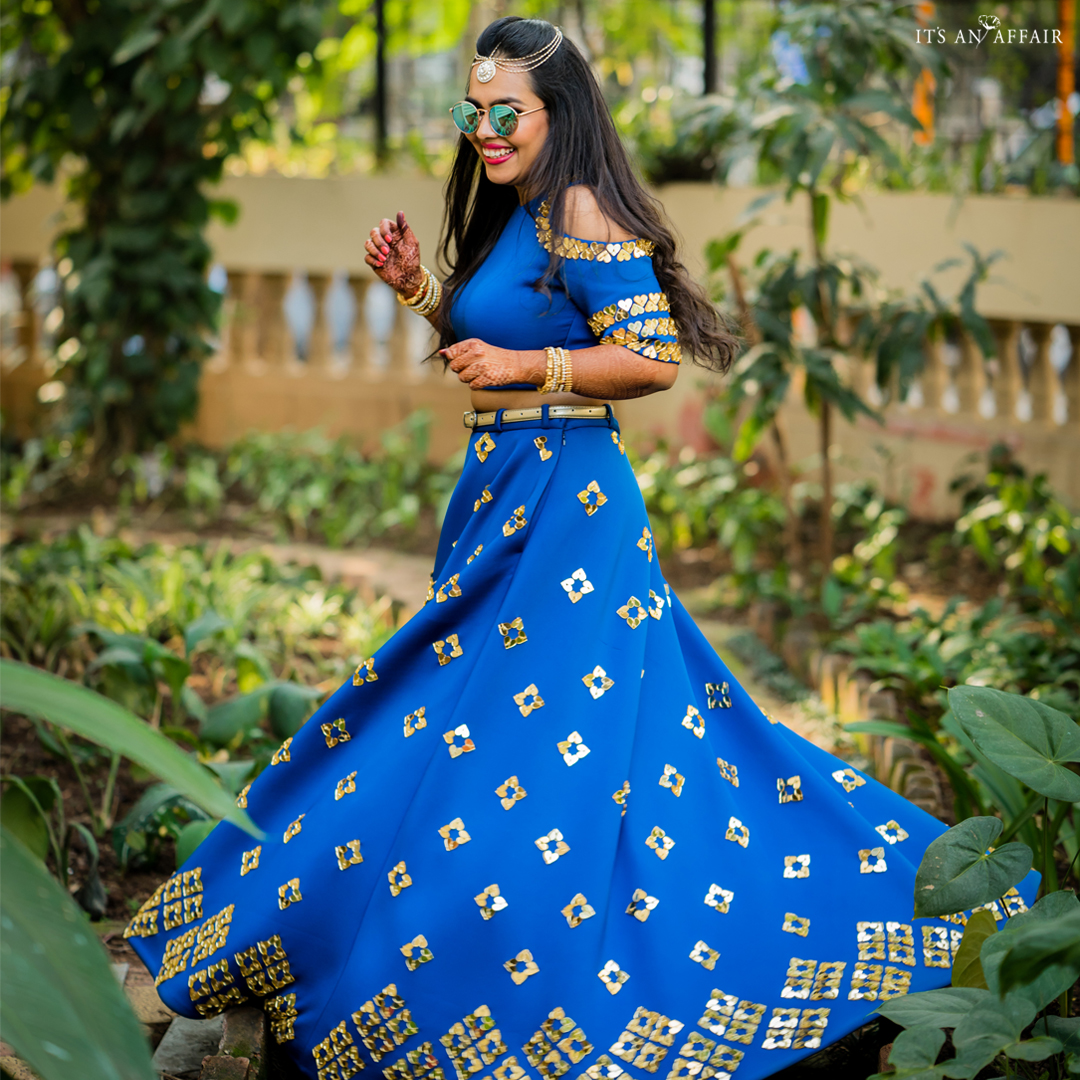 Twirling Bride to Be in Blue Outfit in Mehendi Ceremony