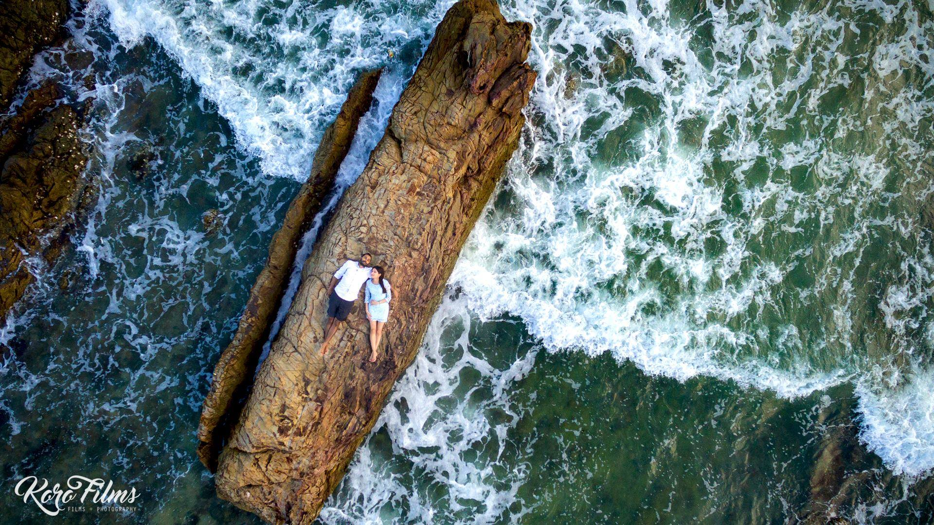 Dreamy Couple Pre Wedding Photoshoot on a Wood in the Middle of Sea