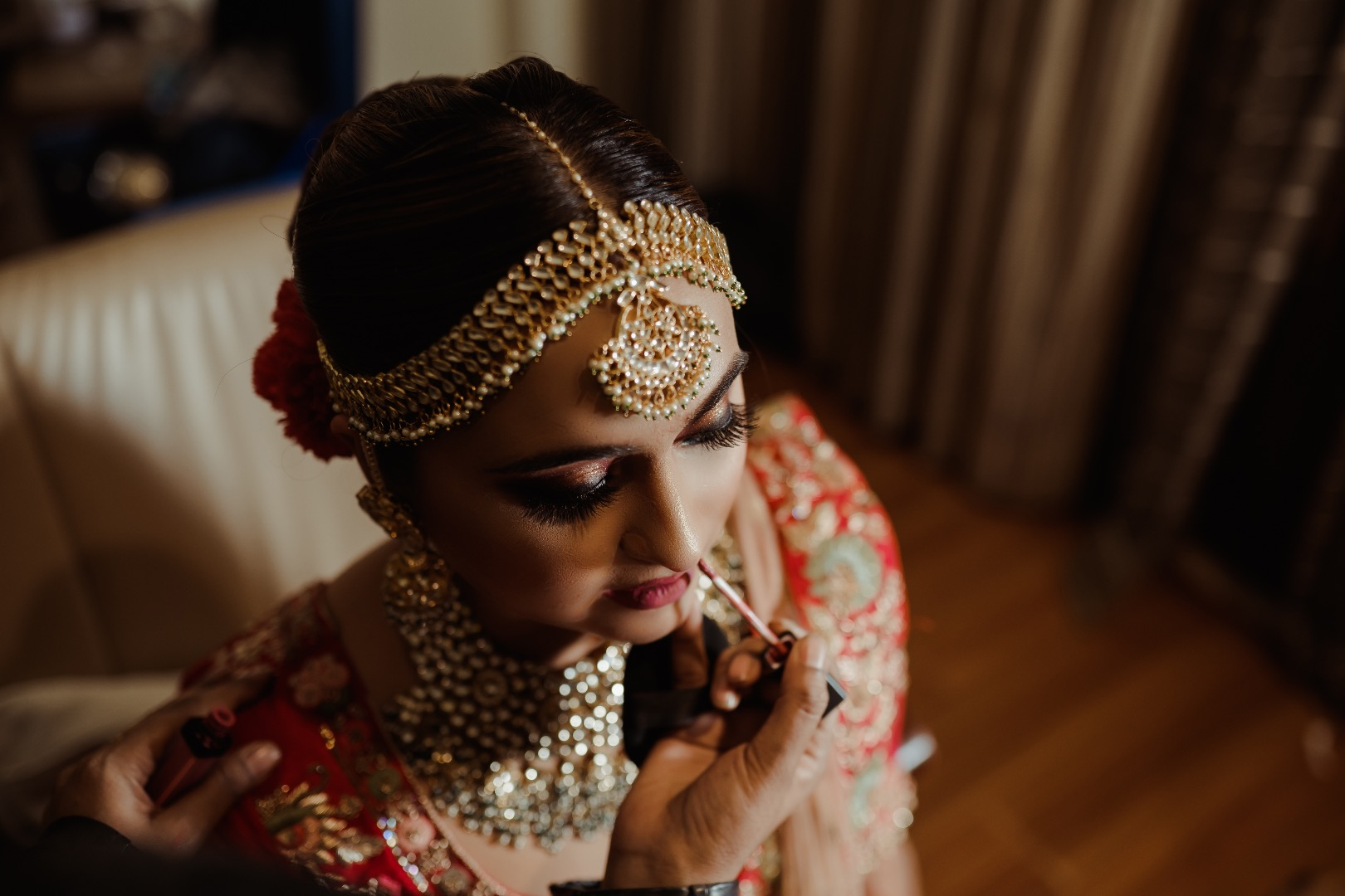 Beautiful bride in red with gorgeous maang tikka