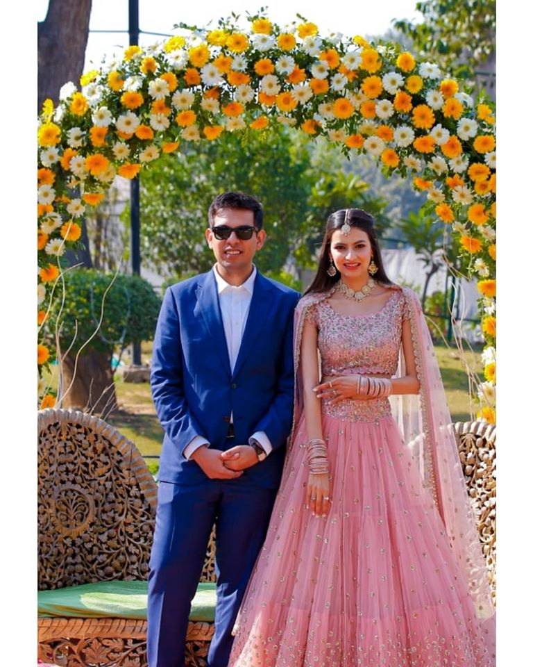 Bride & Groom at Wedding Ceremony with Yellow & White Floral Decor