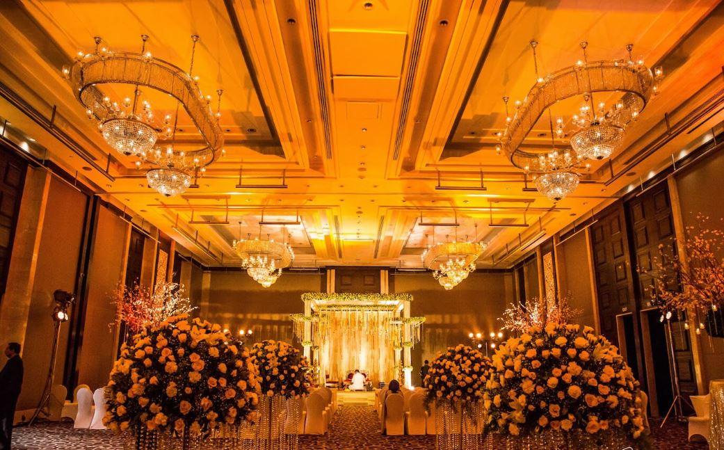 Grand Yellow Flowers & Chandeliers Indoor Wedding Decor