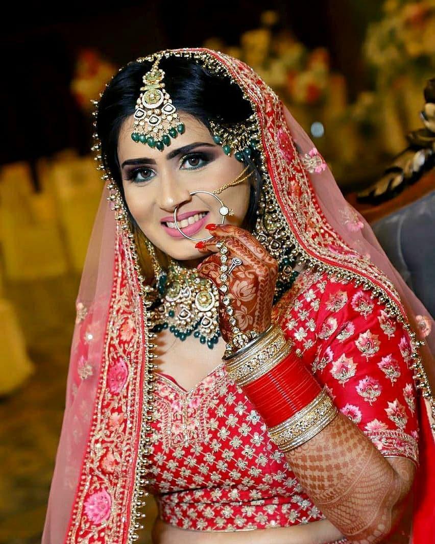 Beautiful bridal makeup for red lehenga