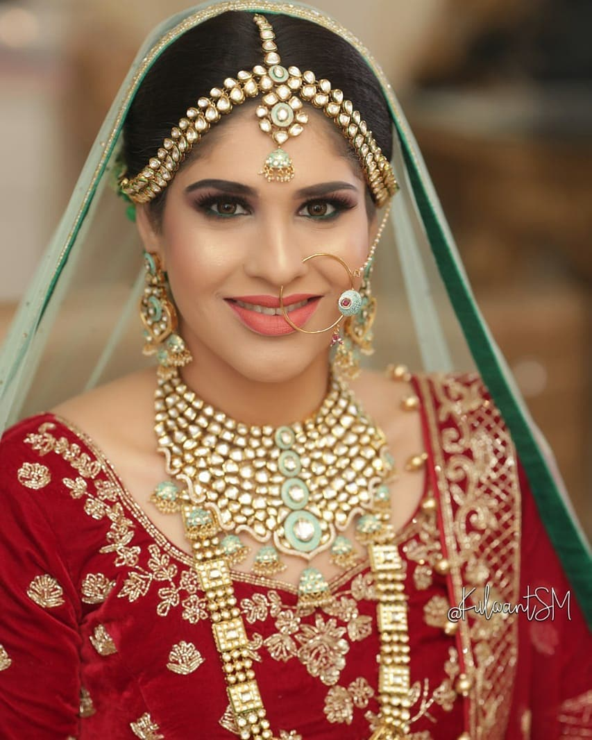 Beautiful Cut Crease Smokey Eye Makeup and Nude Lips for Red Bridal Look