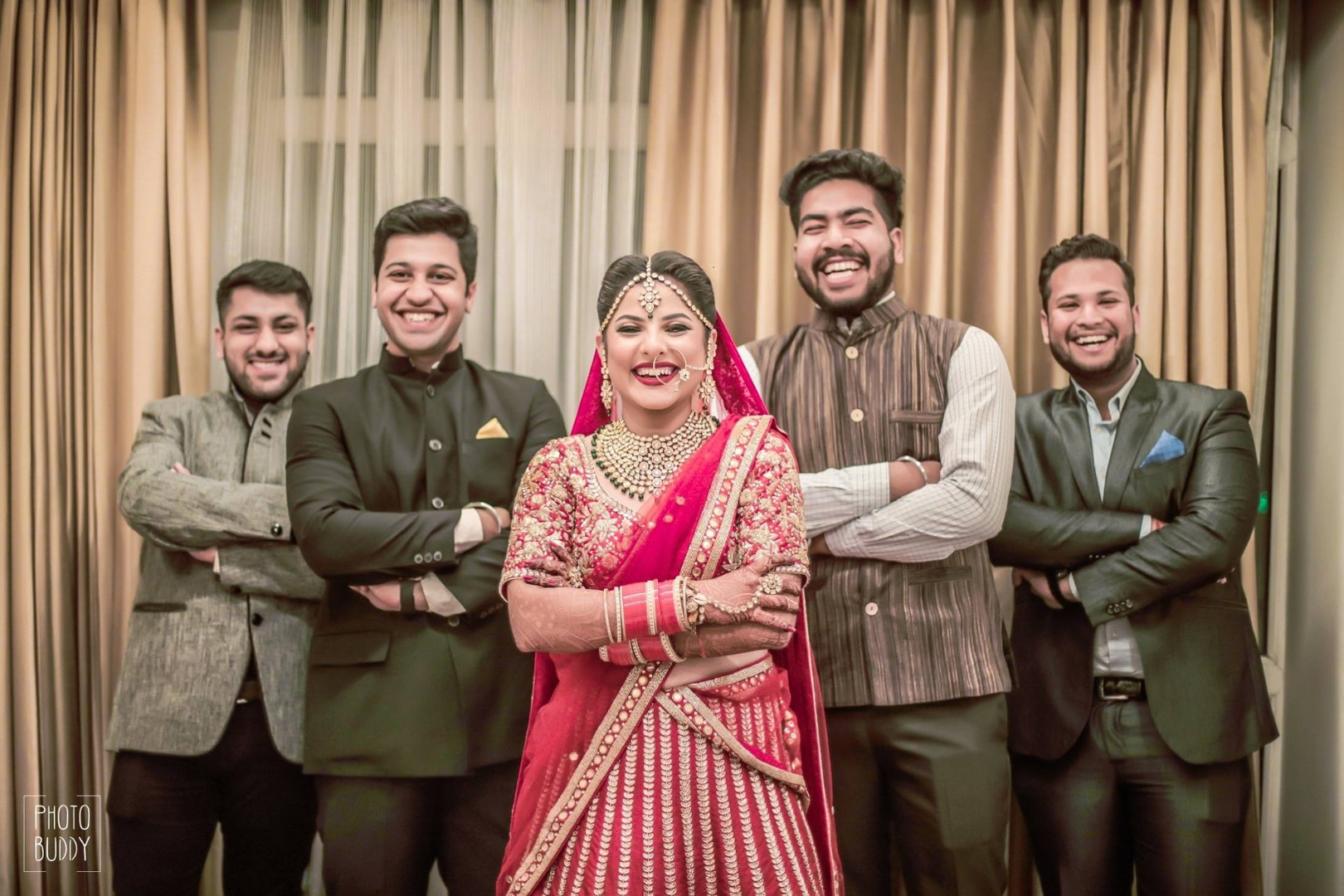 Bride posing along with her brothers