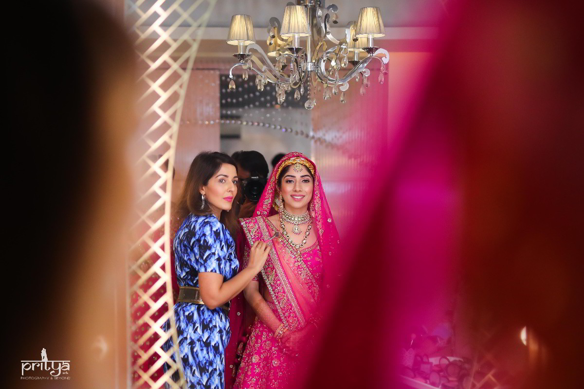 Bride with her Sister getting ready for her big day