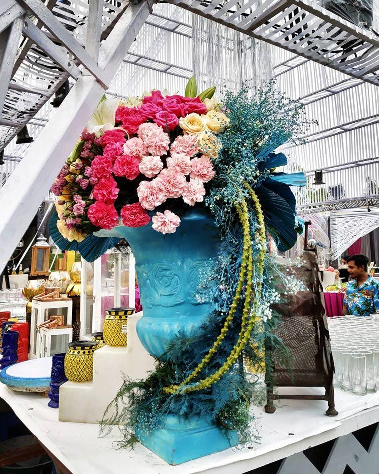 A huge Blue Flower Pot with Exotic Colorful Flowers Bar Decor Idea