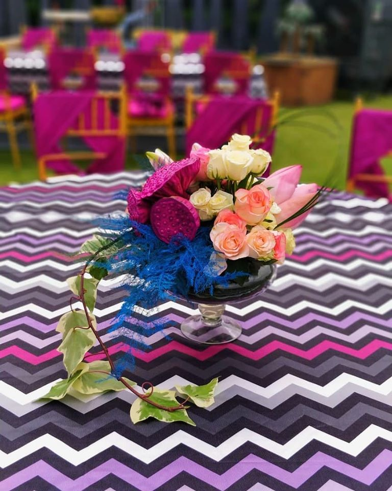 Floral Centrepiece and Aztec Printed Cover Table Decor