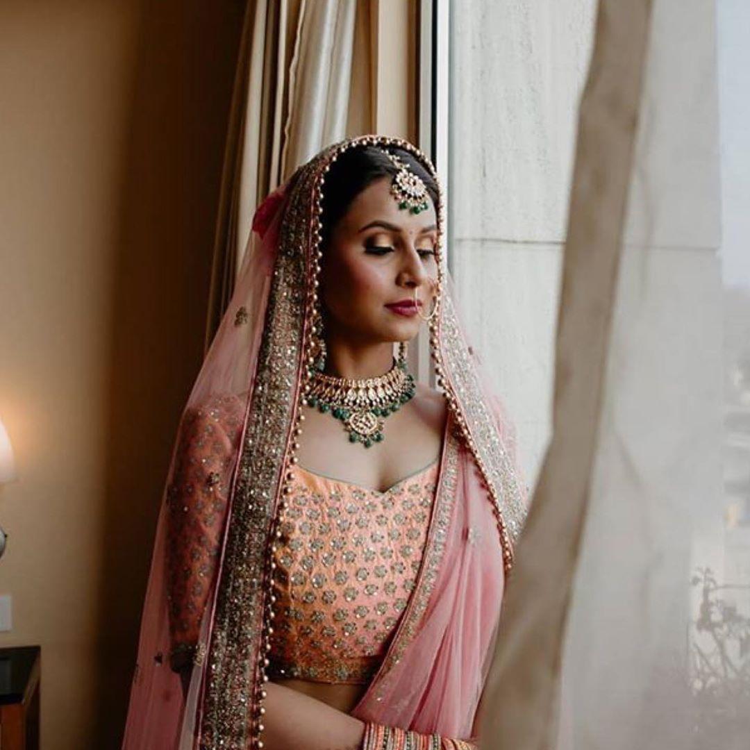 Pink lengha bridal makeup and hair