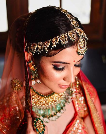 Orange Bridal Lehenga with Golden and Green Jewelry