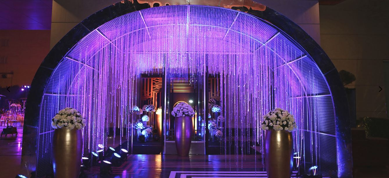 Crystal Hangings & White Flowers Sangeet Ceremony Entrance Decor