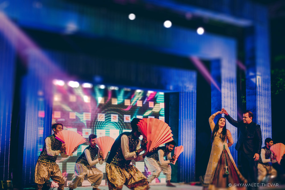 Sangeet Stage Lighting Decor and Bride Dancing