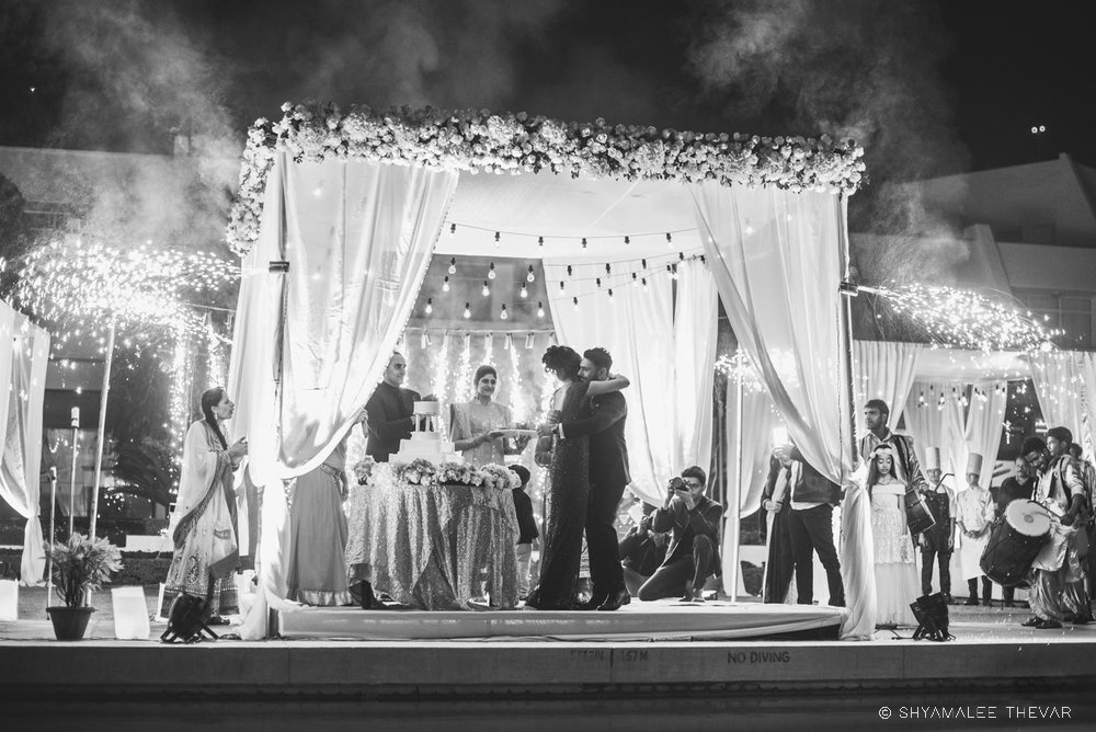 Blck & White Reception Ceremony Picture with Floral Draped Setup & a Wedding Cake