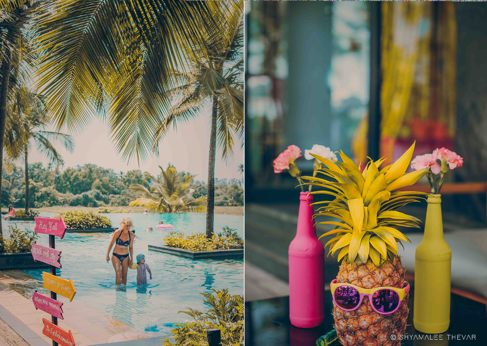 Colorful Pool Party Signage and Colorful Pineapple & Flower Bottle Table Centerpiece