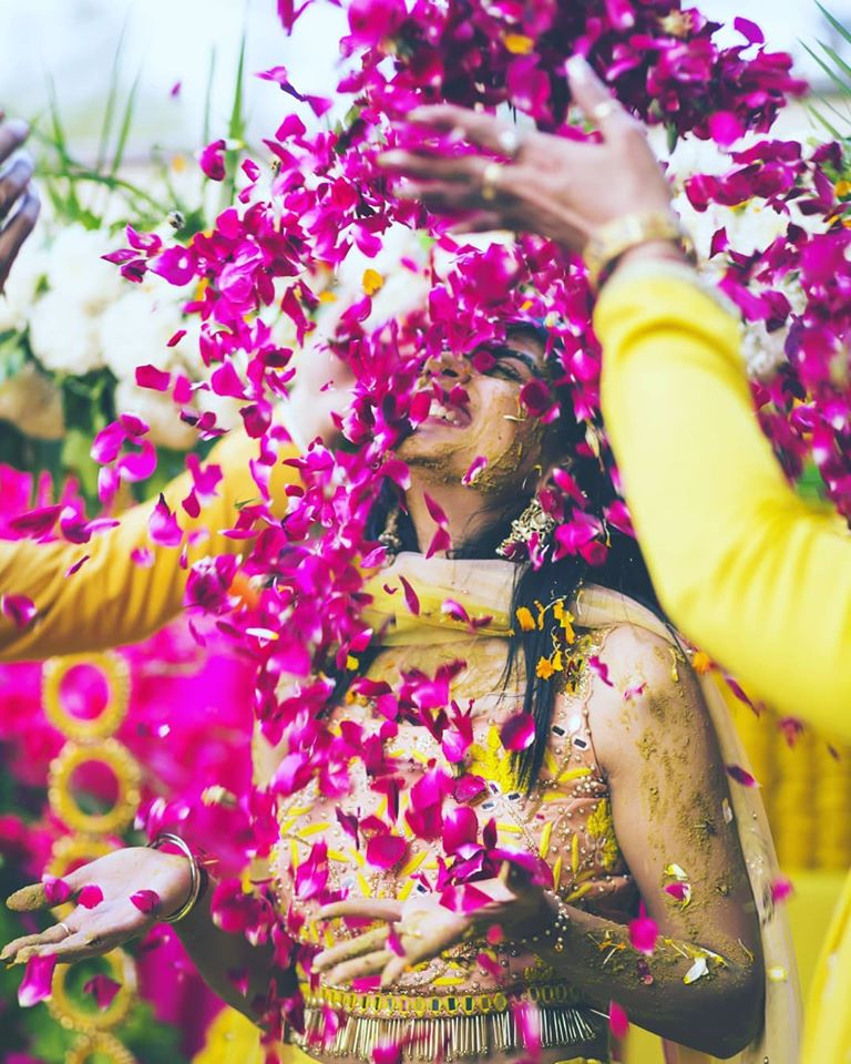 Beautiful Candid Picture of a Bride in Haldi Ceremony with Rose Petals