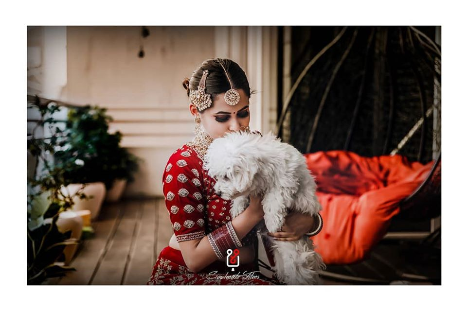 Beautiful Picture of a Bride with her Pet Dog