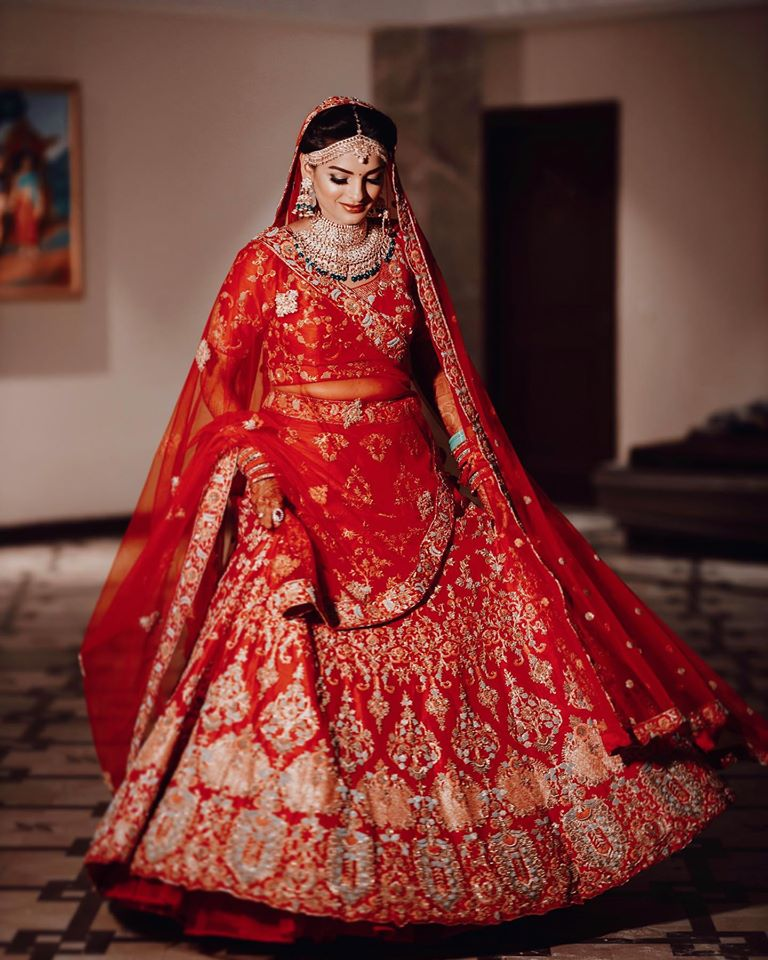 Blood Red Lehenga with Golden and Green Jewelry
