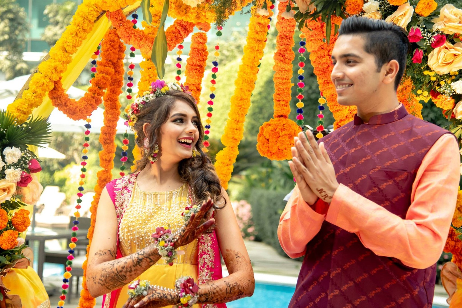 Colouful Floral Mehendi Ceremony Decor and a Beautiful Couple