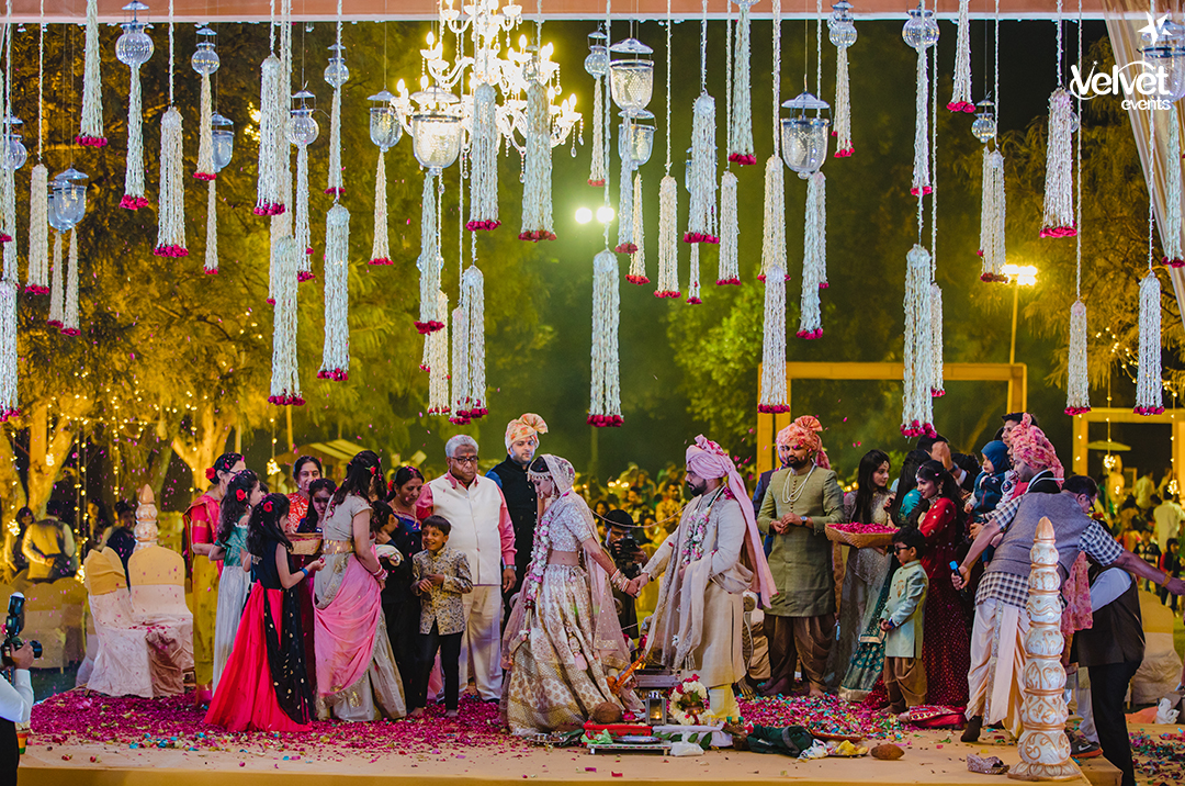 Beautiful Mandap Decor with Floral Ceiling and Chandelier