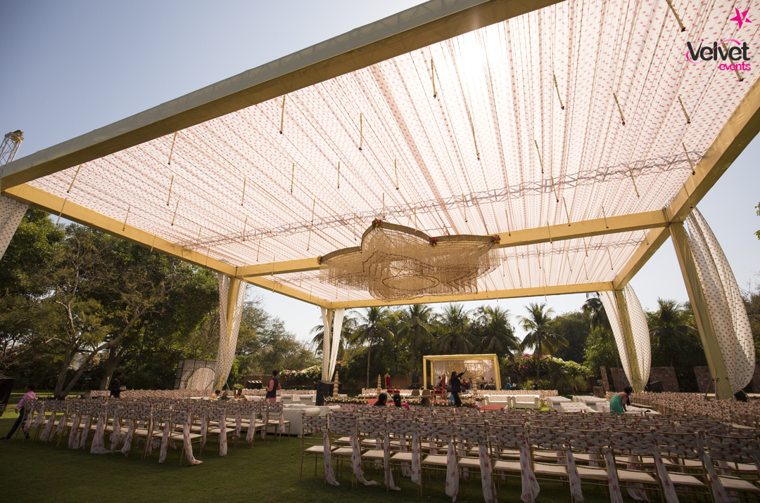 Outdoor Wedding Decor with a Big Flower Shaped Chandelier in the Middle