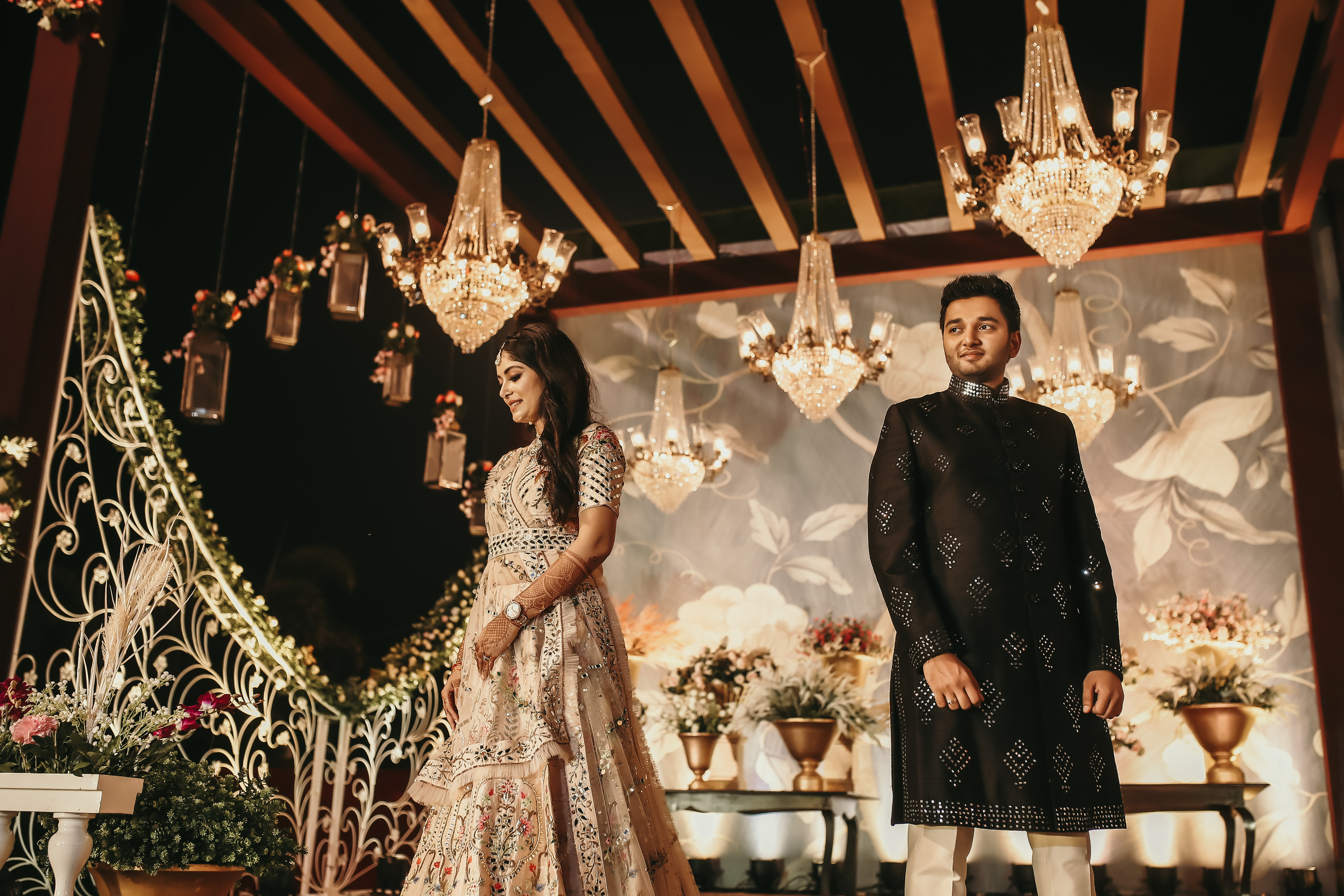 Royal Chandeliers Sangeet Ceremony Decor and Beautiful Bride & Groom