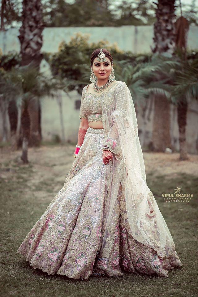 Indian Bride in White Ivory Wedding Lehenga