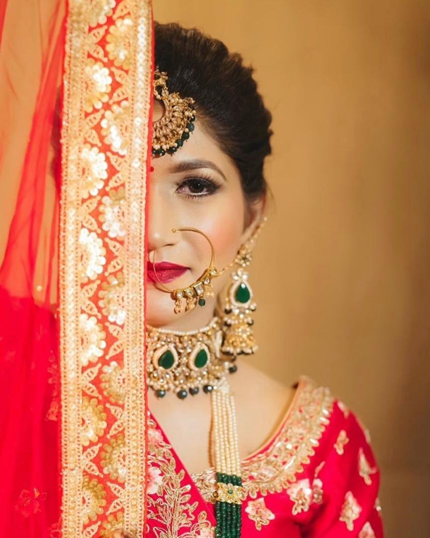 Beautiful bridal red lehenga hair and makeup