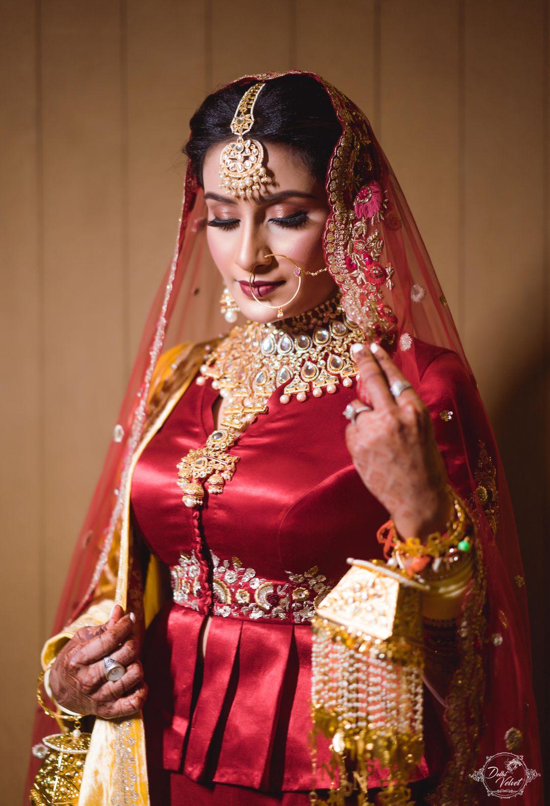 bridal lehenga with gold jewellery