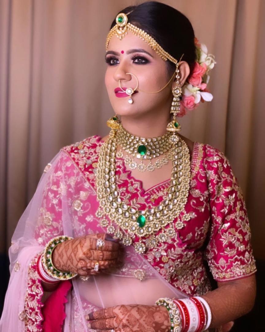 Pink and Golden Bridal Lehenga