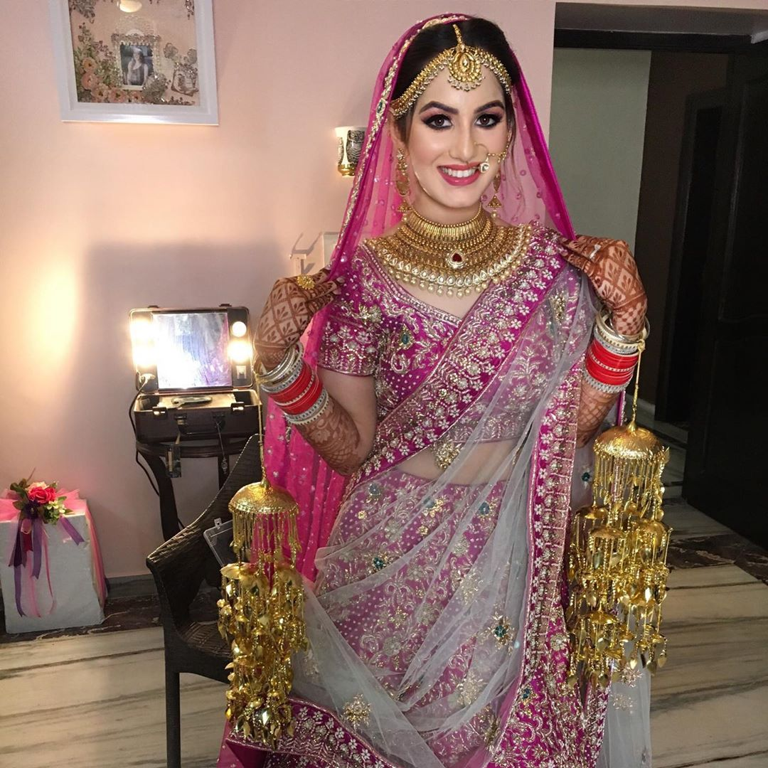 Pink Bridal Lehenga with Golden Jewelry